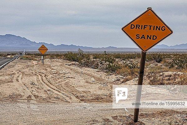 Drifting sand road sign in Mojave Desert  Rice  California  USA.
