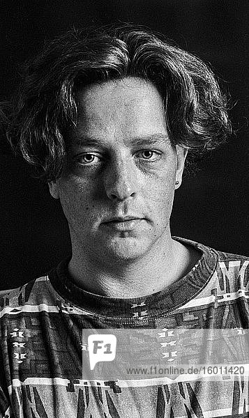 Tilburg  Netherlands. Front view studio portrait of a young adult  caucasian male suffering from a huge depression. Shot on Analog Black & White Film in 1995.