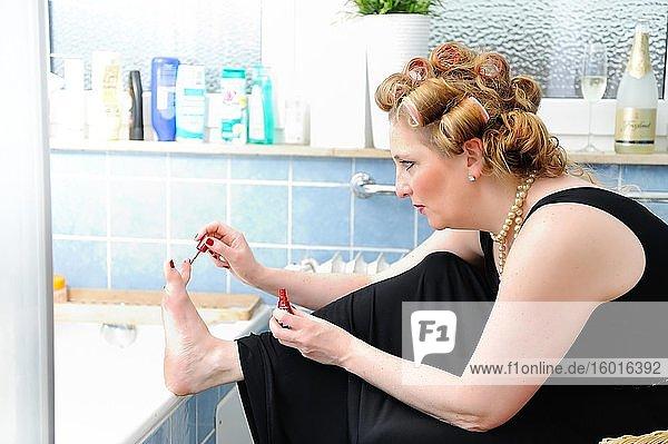Woman painting her toenails  Corona Series  Germany  Europe
