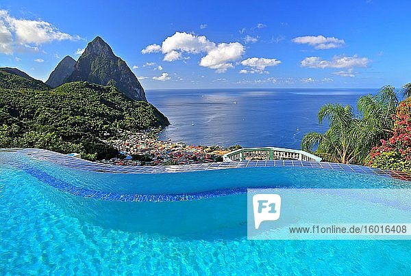 Swimming pool of the La Haut Resort with view of the village and the two Pitons  Gros Piton 770m and Petit Piton 743m  Soufriere  St. Lucia  Lesser Antilles  West Indian Islands  Caribbean Sea