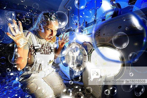 Woman in front of washing machine  Corona Series  Germany  Europe