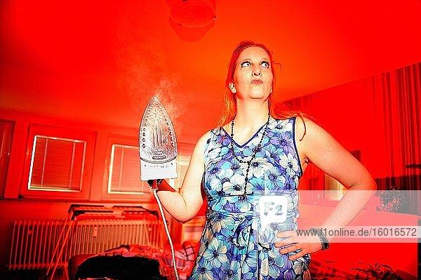 Woman ironing  Corona Series  Germany  Europe