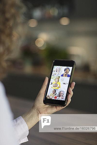 Senior women friends video chatting on smart phone screen
