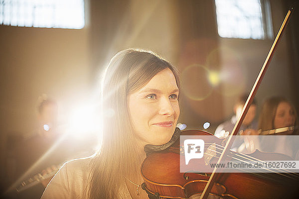 Smiling violinist performing