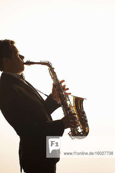 Silhouette of saxophonist performing