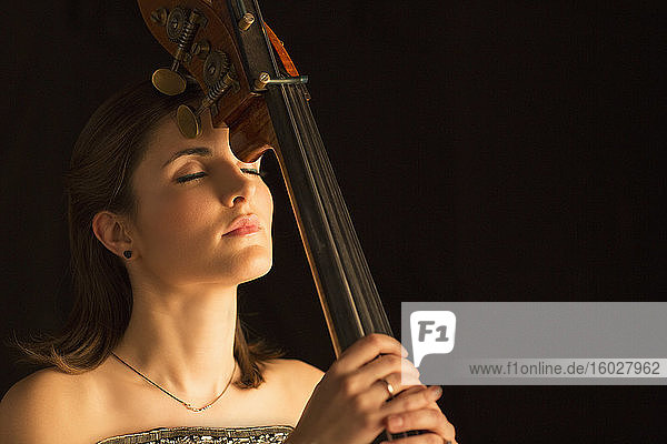 Serene woman with double bass