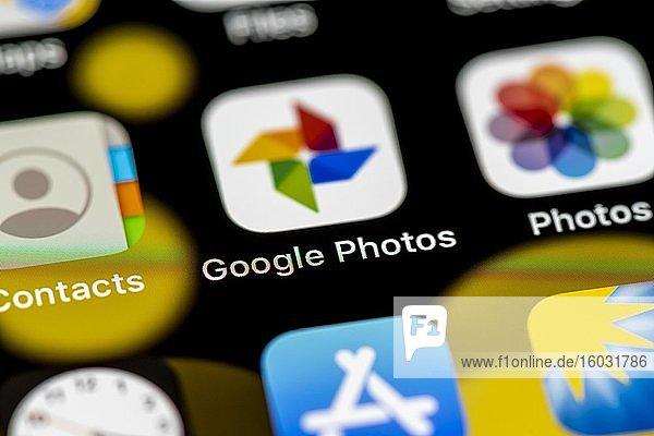 Google Photos und Apple Photos Icon  App Icons auf einem Handy Display  iPhone  Smartphone  Nahaufnahme