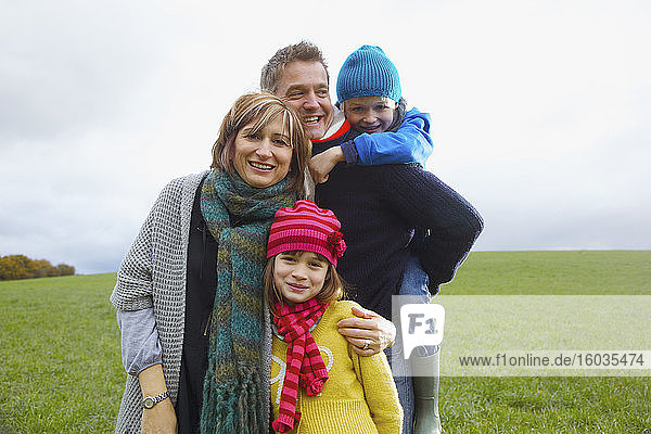 Portrait happy family in grass field