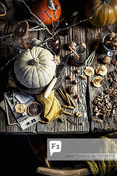 Autumn pumpkins  spices  nuts and dried fruits on the table