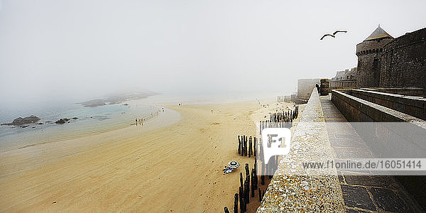 France  Bretagne  Saint-Malo  Beach and fortress in fog