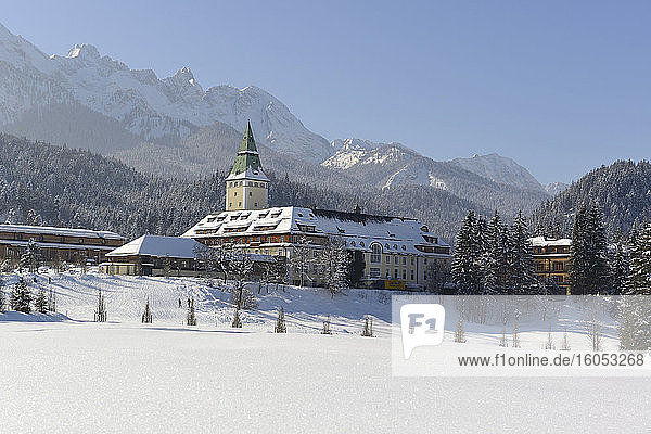 Germany  Bavaria  Schloss Elmau in snow-covered Wetterstein Mountains
