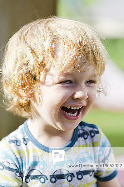 Austria  Boy laughing and looking away  close up