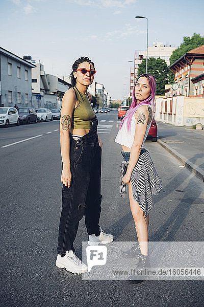 Portrait of two young women standing on the street in the city