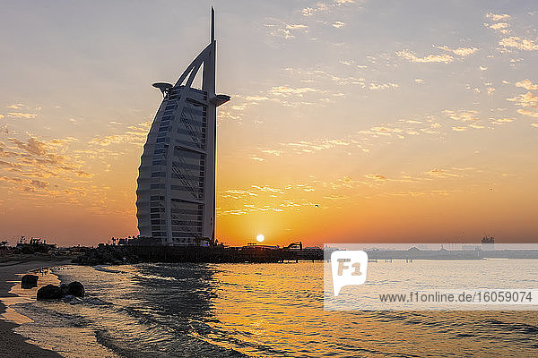 Sunset behind Burj Al Arab; Dubai  United Arab Emirates