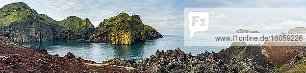 Rugged rock and cliffs along the coastline of the island of Heimaey  a part of an archipelago along the Southern coast of Iceland; Vestmannaeyjar  Southern Region  Iceland