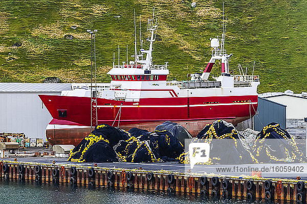 Fishing boat and supplies on a dock in a harbour; Rangarping eystra  Southern Region  Iceland