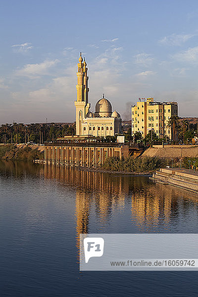 Mosque on the Nile reflected in the water; Aswan  Egypt