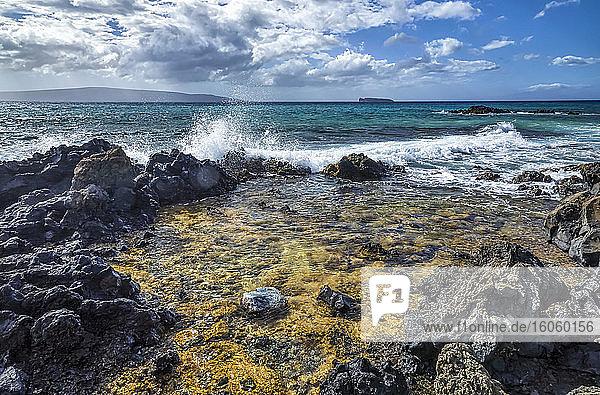 Coast of Maui with rugged lava rock and turquoise water; Kihei  Maui  Hawaii  United States of America