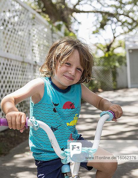 smiling 5 year old boy on his bike Georgia