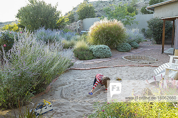 4 year old boy playing in his back yard