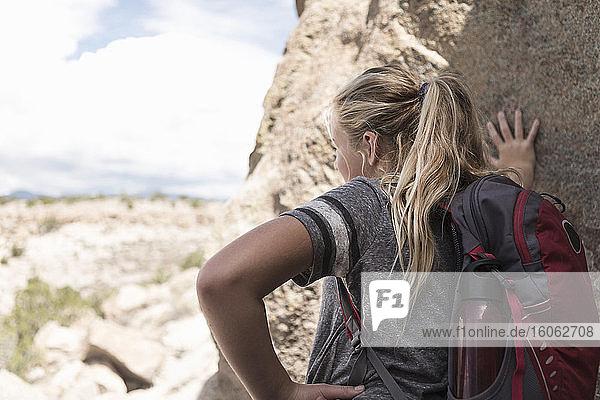 12 year old girl hiking in Tsankawi Runis NM.