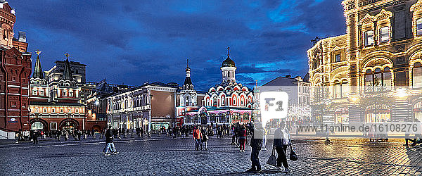 view of Kazan Cathedral in the night and the illuminated street of St Nicolas  on Red Square  Moscow  most recognizable classic landmark of Russia and UNESCO World Heritage Site.