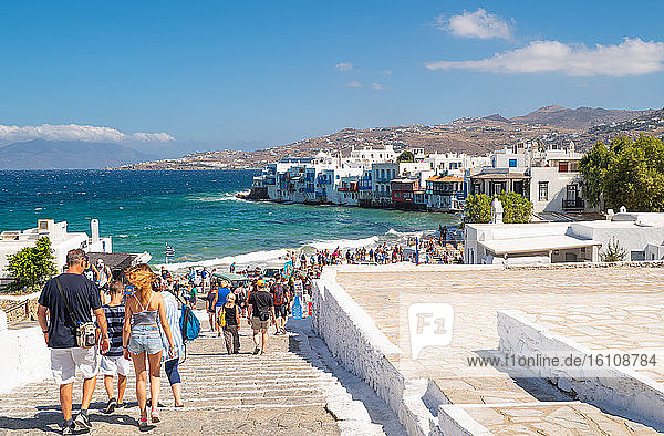 Mykonos  Greece  A crowd of tourists goes to the Little Venice area of the Chora old village