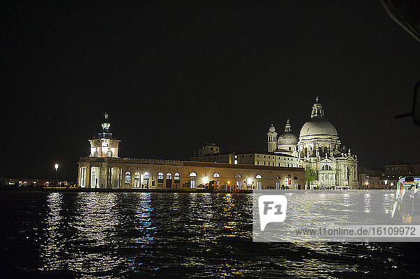 Europe  Italy  Veneto  Venice. City built on the Adriatic Sea lagoon. City of water canals instead of roads. Capital of the Serenissima Republic of Venice. UNESCO World Heritage Site. Church of S. Maria della Salute at night