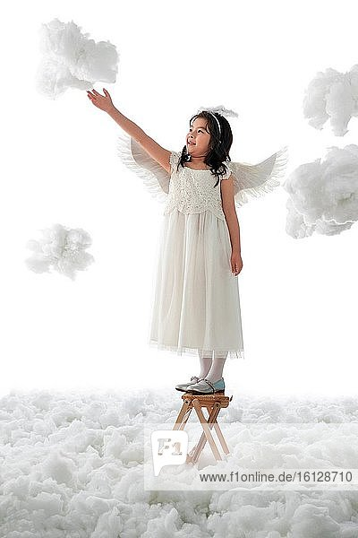 Standing on a ladder play little angel