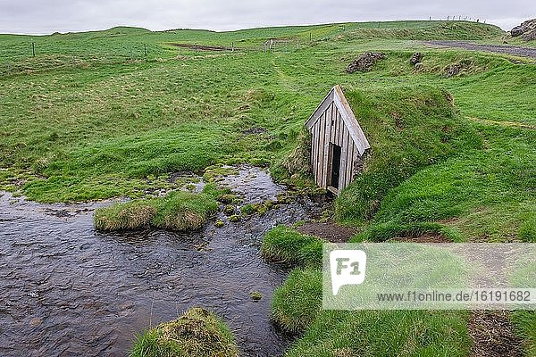 Small river next to Keldur Turf House museum in south part of Iceland.