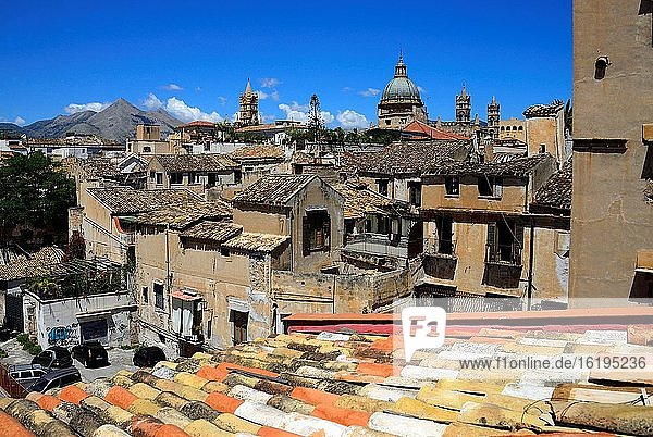 In foreground architecture of old town of Palermo  In background towers and Cupola of Roman Catholic Archdiocese of Palermo  Cathedral dedicated to the Assumption of the Virgin Mary  Cathedral of Santa Maria Assunta  Cattedrale di Palermo  historic part of Palermo  Sicily  Italy  Europe
