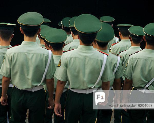 Policemen walking in Tiananman Square