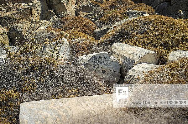 Fallen broken columns at archaeological site  Delos Island  Greece