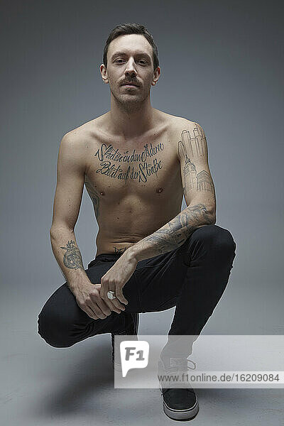 Portrait of young man with tatoos