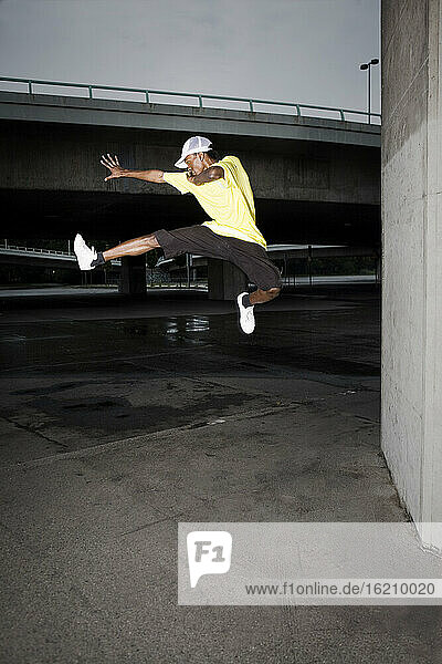 Germany  Cologne  Young man jumping