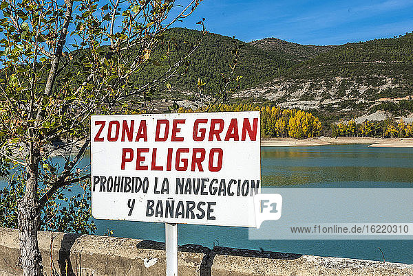 Spain  Aragon  lake of Pena irrigation dam on the Rio Gallego  danger signal