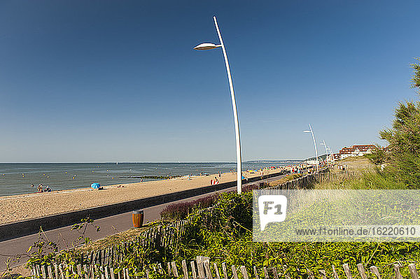 The crowded though quiet beach and environmental friendly path,  Cabourg,  France