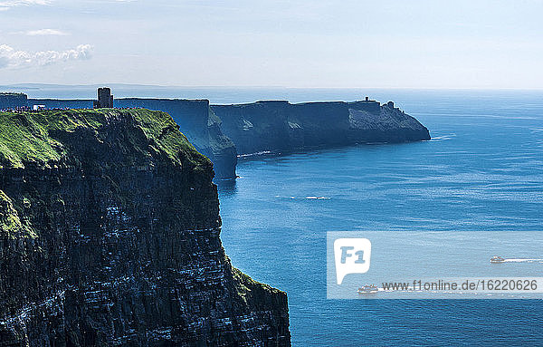 Europe  Republic of Ireland  Clare County  Burren and Cliffs of Moher Geopark (UNESCO World Heritage)  view on the O'Brien tower and the South cliffs