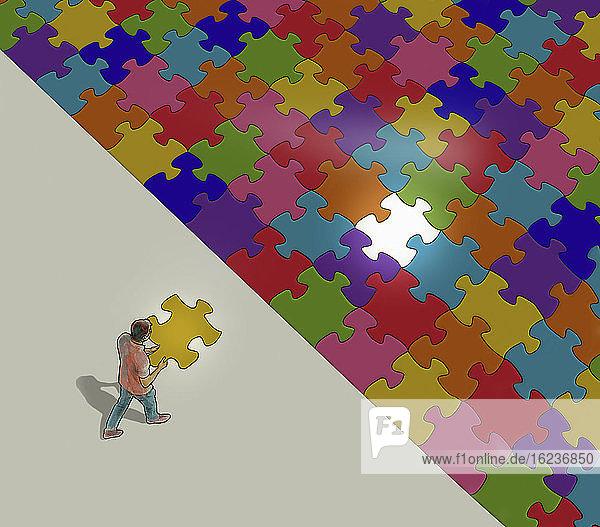 Mann mit dem letzten Puzzleteil