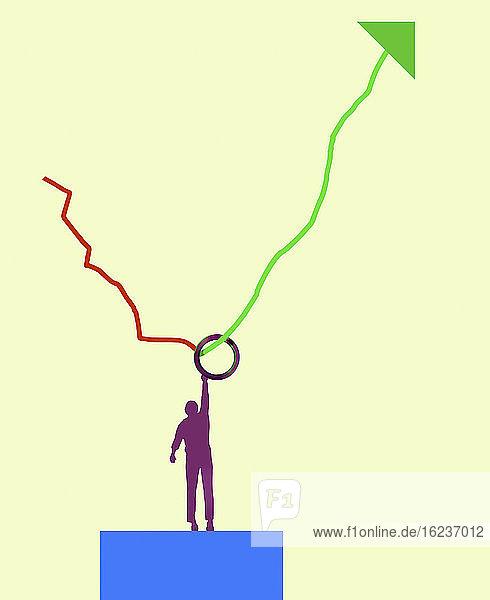 Mann greift nach oben  um den Aufschwung im Diagramm festzuhalten