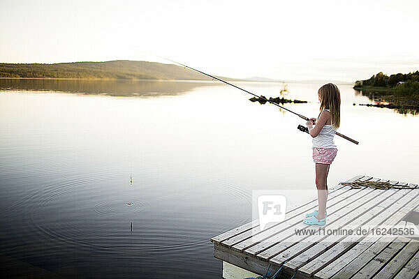Girl fishing in lake