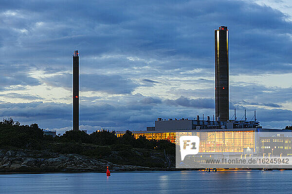 Illuminated industrial building at sea