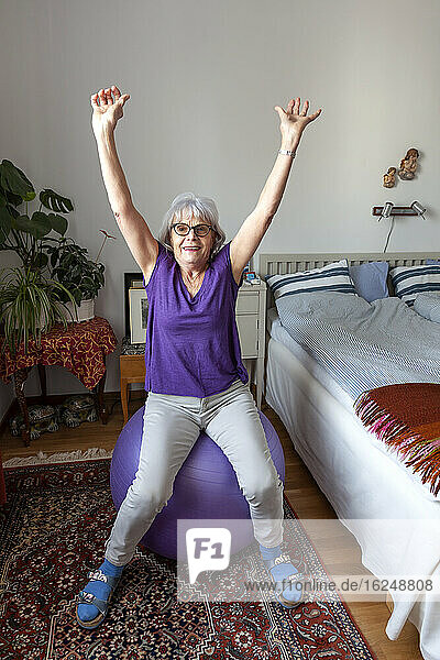 Senior woman exercising on fitness ball