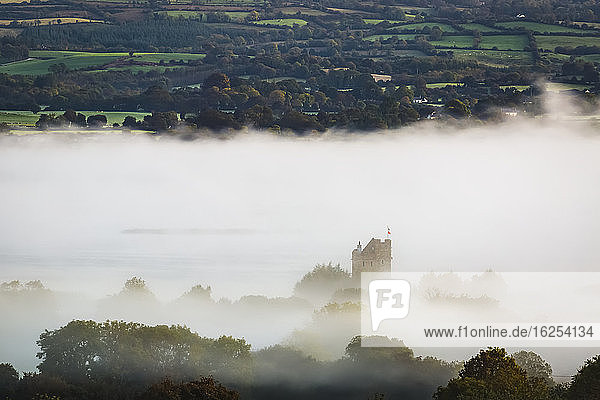 Castlebawn Tower house obscured from the fog over Lough Derg; Clare  Ireland