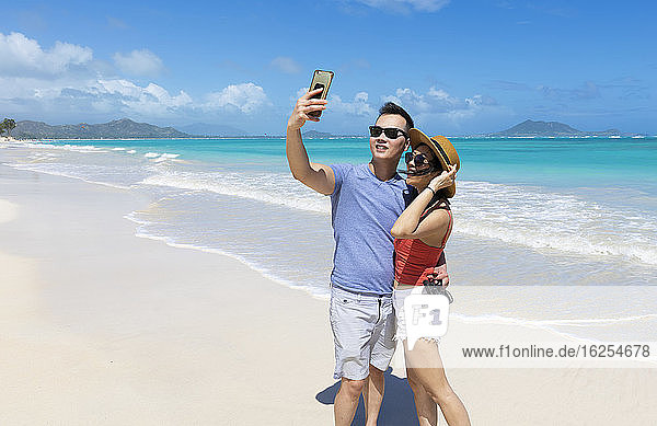 An Asian couple enjoying a vacation at Kailua Beach Park: Kailua  Oahu  Hawaii  United States of America