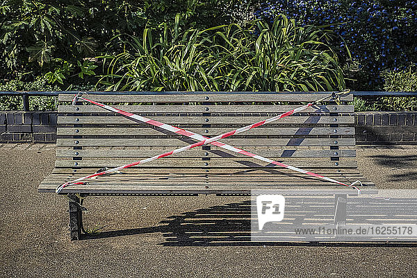 A park bench is roped off during the national lockdown  Covid-19 Global Pandemic; London  England