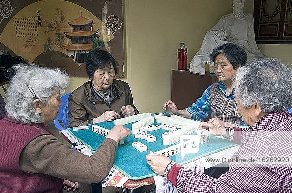 CHINA Elderly women playing mahjong in a park in Kunming  Yunnan province.Photo by Julio Etchart.