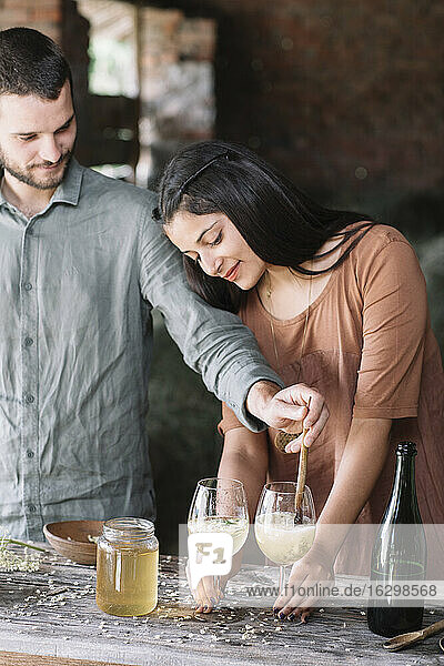 Couple preparing cocktail together
