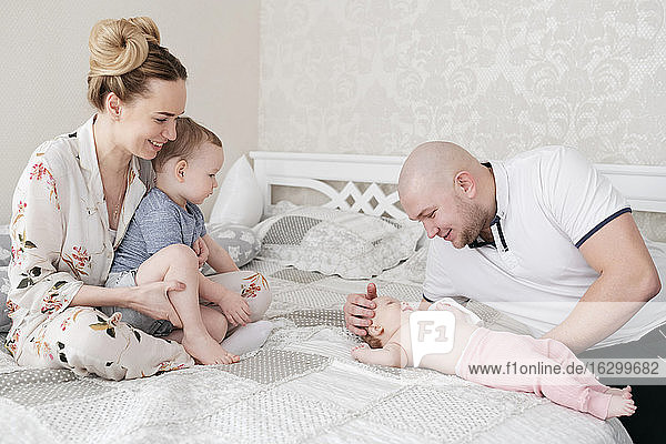 Parents and their children on bed