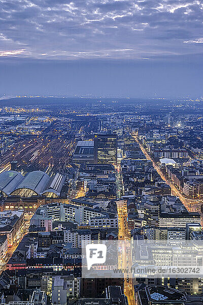 Germany  Hesse  Frankfurt  main station left and city view in the evening